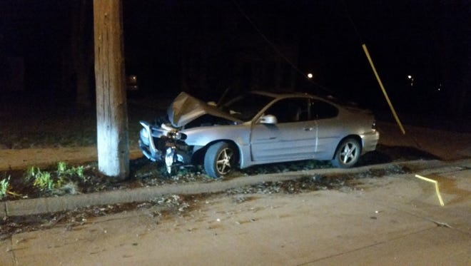 Police say a woman crashed her vehicle into a utility pole on 22nd Street early Wednesday morning.