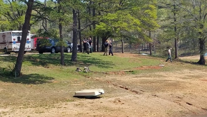 Anderson County investigators work the scene where a body was found Tuesday afternoon off Ponderosa Point on Lake Hartwell.