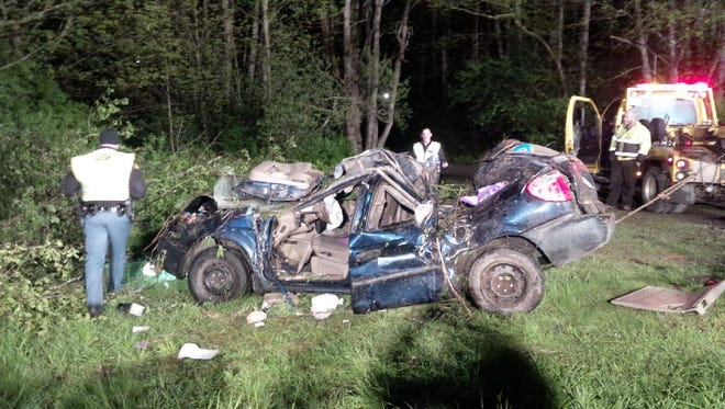 Troopers investigate the crash Wednesday that killed Tyrisha Bills Hamilton, 37, of Bremerton.