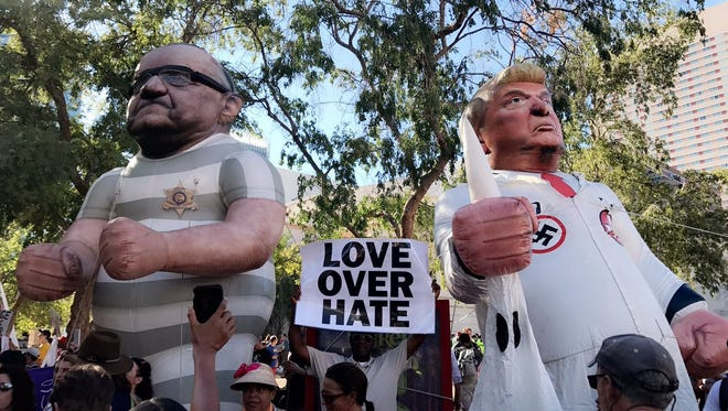 Blowup dolls are erected of former Maricopa County Sheriff Joe Arpaio and President Donald Trump on Aug. 22, 2017 outside Trump's rally at the Phoenix Convention Center.