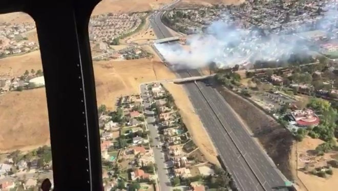 A brush fire on Highway 118 in Simi Valley Saturday afternoon closed the freeway for a time. Firefighters contained the blaze at 1.2 acres.