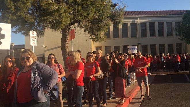 Hundreds of teachers marched in solidarity with #RedForEd before a district rally at the Chandler Center for the Arts March 26, 2018.