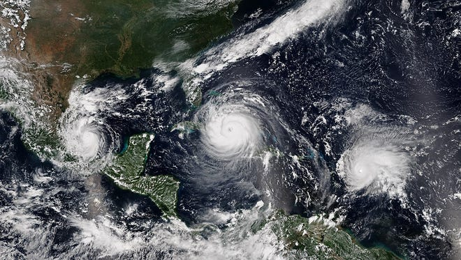 Three hurricanes (Katia, Irma and Jose) spin in the Gulf of Mexico and Atlantic Ocean in 2017. Forecasters don't think a repeat of the active 2017 is likely in 2018.