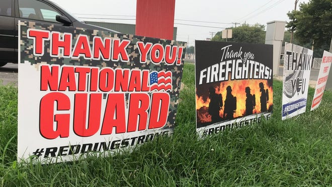 There are many signs in downtown Redding thanking the National Guard, firefighters and law enforcement for helping in the Carr Fire.