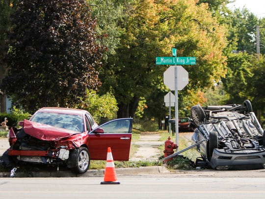 The scene of a rollover car crash at the corner of