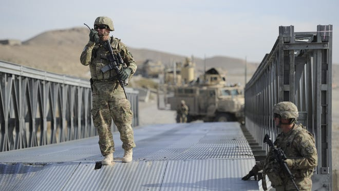 Lt. George Lopez, left, and Staff Sgt. Tim McNiel inspect a bridge.