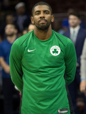 Boston Celtics' Kyrie Irving looks on during the first half of a preseason game against the Philadelphia 76ers.