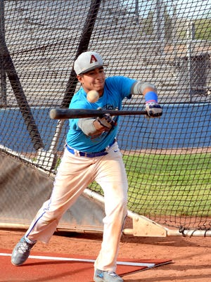 Cavemen senior Josh Chavarria gets a piece of the ball during bunting drills on Wednesday. Carlsbad will open District 4-6A competition Friday at Clovis.