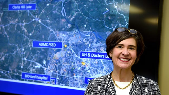 AU Health System CEO Katrina Keefer stands with a map showing AU's proposed free standing emergency department deep in Columbia County.  Photographed in Augusta, Ga., Thursday afternoon February 20, 2020.