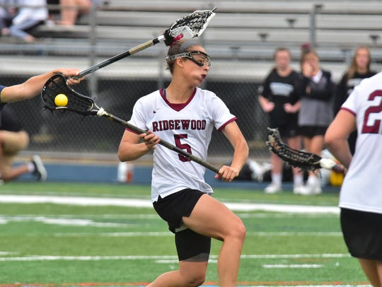 Ridgewood Jackie Wolak scores vs. Oak Knoll in the