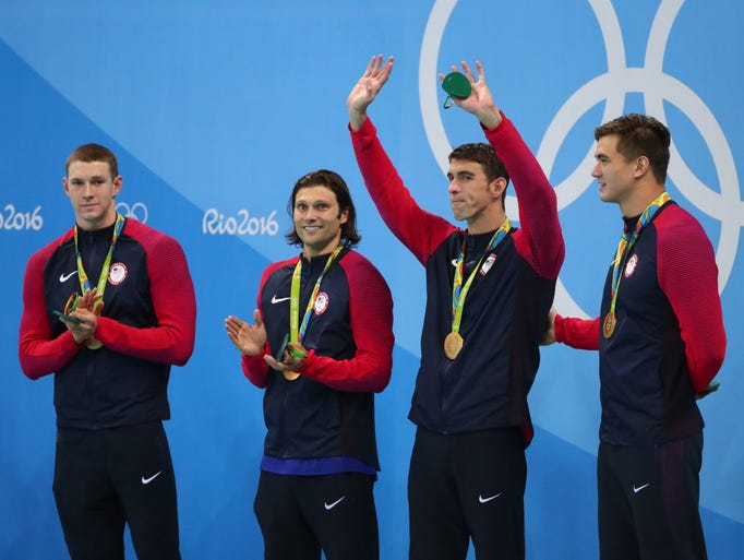 Michael Phelps and teammates celebrate on the podium
