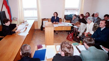 In this 1999 file photo, a group of Jehovah's Witnesses, right, sit in court during their trial in Moscow when a Moscow court sought to ban the religious group.