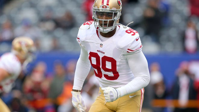 49ers linebacker Aldon Smith warms up before a game against the New York Giants in November of 2014.