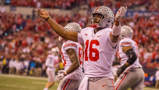 Ohio State quarterback J.T. Barrett pumps up the crowd after scoring a touchdown in Saturday's Big Ten Championship Game.