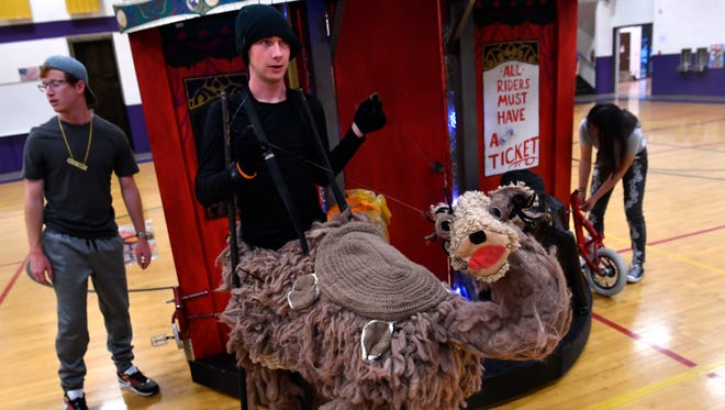 Coltyn Cook, a Wylie High School sophomore, manipulates his camel puppet during the final Destination Imagination dress rehearsal on May 17. Four Wylie teams and two from Abilene Christian Schools are competing against DI teams from around the world this week in Knoxville, Tennessee.