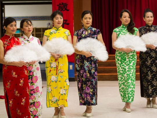 The Golden Autumn Runway Walking Club shows off traditional Chinese movement and attire.