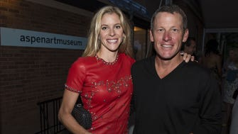 In a file photo from 2013, Anna Hansen and Lance Armstrong attend a benefit at the Aspen Art Museum.
