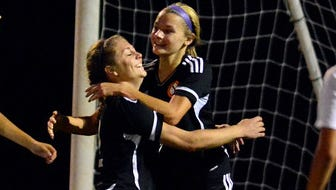 Northeastern's Amanda Leisses, left, and Brittany Arentz celebrate Arentz's second-half goal against Central York last season. Arentz is the York-Adams Division I Player of the Year.