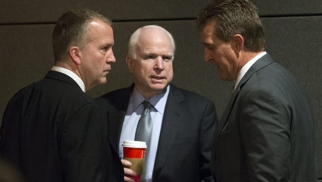 Sen. John McCain, R-Ariz., center, wants the next president to nominate the replacement for Supreme Court Justice Antonin Scalia, who was found dead Feb. 13. Sen. Jeff Flake, R-Ariz., right, sits on the Senate Judiciary Committee but has not yet made his position clear.