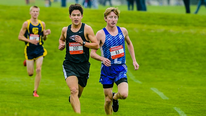 Paul McKinley, 237, of Okemos and Evan Meyer ,63, of East Lansing are among the top returning runners in the Lansing area this fall.