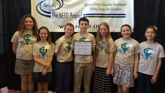 Member of the Virginia Chance School Green Team stand with an award for best energy project in the state. The team's project was recently recognized as the best in Kentucky.