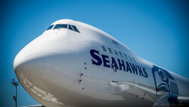 Boeing unveiled photos of a new Seattle Seahawks-themed Boeing 747-8 Freighter on July 19, 2015.