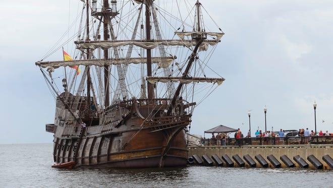 Visitors take a tour of the Spanish tall ship El Galeon, a colonial era Spanish galleon replica Sunday at Plaza de Luna.