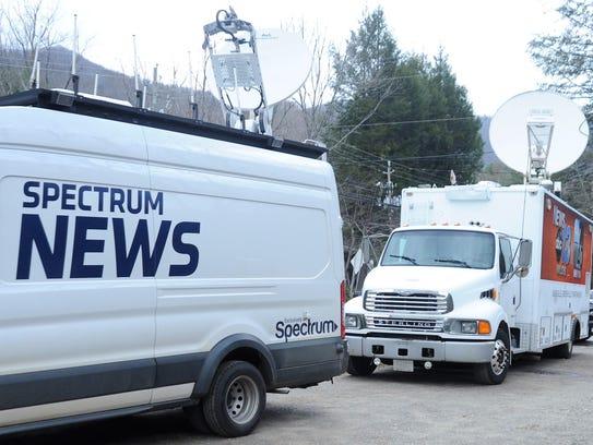 News trucks on Feb. 21 fill the parking lot beside