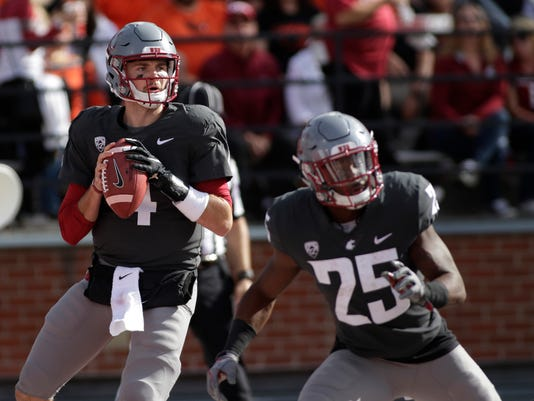 FILE - In this Sept. 16, 2017, file photo, Washington State quarterback Luke Falk (4) looks to pass during an NCAA college football game against Oregon State in Pullman, Wash. After arriving at Washington State as a walk-on, Falk will leave as one of the most productive passers in Pac-12 history. He has thrown for 12,893 yards with 108 touchdowns for his college career, setting school records for career TD passes, passing yardage and total offense. (AP Photo/Young Kwak, File)