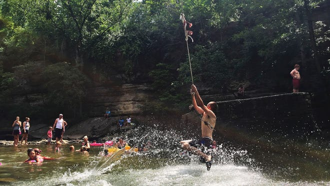 Big Rock is a popular place to cool off along Beargrass Creek in Cherokee Park, but sewage system spills put the public at risk in a park where children have long liked to splash or wade in the water, especially at the Big Rock.
