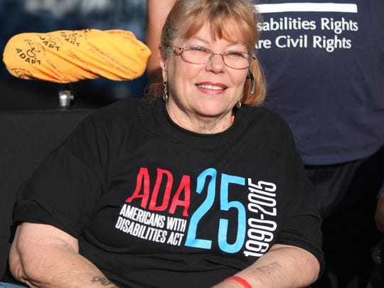 """Daniese McMullin-Powell, who chairs the state Council for Persons with Disabilities and coordinates the grassroots ADAPT Delaware advocacy group, joined Sunday's celebration welcoming the national """"Road to Freedom"""" bus at Rodney Square on the 25th anniversary of the Americans with Disabilities Act."""