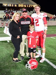 UL coach Mark Hudspeth poses after a win at Texas State