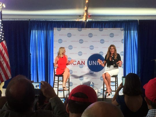 Caitlyn Jenner, right, speaks at an American Unity Fund brunch at the Rock and Roll Hall of Fame in Cleveland on July 20, 2016, on the sidelines of the Republican National Convention. Jenner said it was easier to come out as transgender than it was as a Republican. The transgender activist and Olympic gold medalist is speaking at a breakfast at the Republican National Convention to promote LGBT inclusion in the GOP.  On the dais with Jenner is Margaret Hoover of the American Unity Fund.