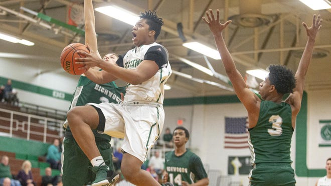 Boylan's Anthony Brown drives to the hoop on Nov. 25, 2019, at Boylan High School in Rockford. The IHSA announced on Thursday it is placing all winter sports, including basketball, for the 2020-21 winter seasons on hold due to COVID-19.