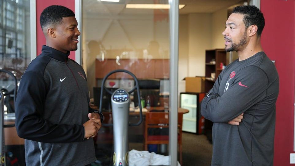 Former Florida State quarterback Jameis Winston meets
