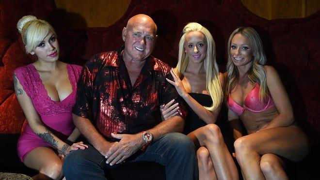 Brothel owner and Nevada businessman Dennis Hof poses for a portrait with, from left, Chanel Baby, Krissy Summers and Willow Love at his World Famous Bunny Ranch near Carson City on July 22, 2015. Hof is considering a run for the U.S. Senate.