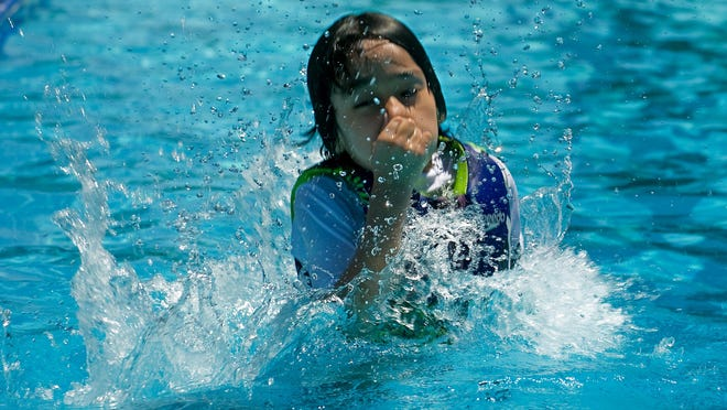 Seven-year-old Roberto Santos of Tracy prepares to submerge himself in the Joe Wilson Pool on Lowell Avenue in Tracy on June 13, 2016. The city of Tracy plans to reopen the pool on June 29 for lap swim, water exercise, swim lessons and recreational swimming by reservation only.