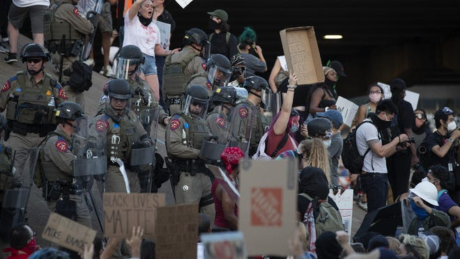 DPS troopers block protesters from getting onto I-35 near at  the Austin Police Department Headquarters on Thursday June 4, 2020.  Hundreds of people gathered at the APD headquarters to protest the killing of George Floyd and Mike Ramos.