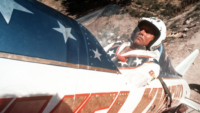In this Sept. 8, 1974, file photo, Evel Knievel sits in the steam-powered rocket motorcycle that will hopefully take him across Snake River Canyon in Twin Falls, Idaho. A company with the rights to figures depicting the late daredevil and entertainer Evel Knievel is on a collision course with the Walt Disney Co. and Pixar over a movie character doll named Duke Caboom.