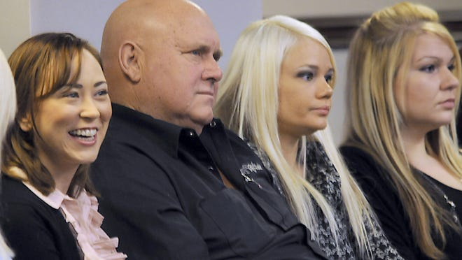 In this 2011 file photo, Dennis Hof, owner of the Moonlite Bunny Ranch and other Nevada brothels, sits in the Assembly chambers of the Nevada Legislature to listen to Harry Reid tell the Legislature that prostitution should be outlawed.