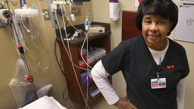 Johnnie Phillips, is 78 and currently a nurse at the Murfreesboro Medical Clinic SurgiCenter on Garrison Drive. Phillips stands in a patient's room Wednesday, Jan. 13, 2016, at the SurgiCenter.