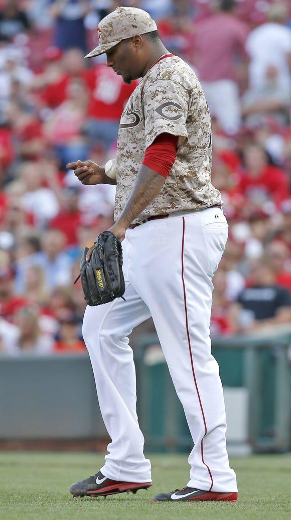 Cincinnati Reds relief pitcher Jumbo Diaz (70) walks