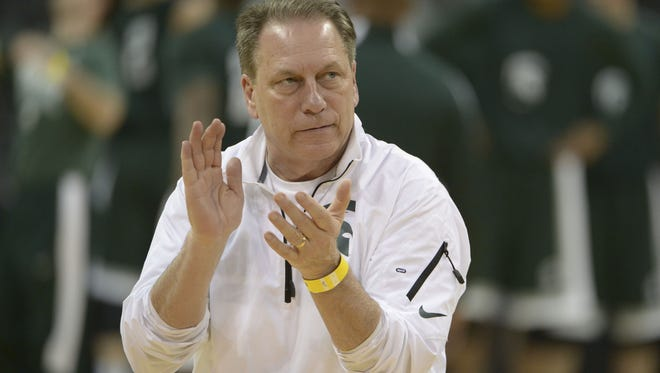 Michigan State basketball coach Tom Izzo claps during practice in Spokane, Wash.