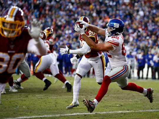 New York Giants tight end Kaden Smith catches a game-winning touchdown pass from quarterback Daniel Jones during overtime of an NFL football game, Sunday, Dec. 22, 2019, in Landover, Md. The Giants won 41-35 in overtime. (AP Photo/Patrick Semansky)