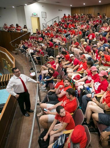 Rep. Mark Cardenas, D-Phoenix, talks to teachers and RedForEd supporters about how the education budget will not be debated till Tuesday or Wednesday of this week, during the third day of the Arizona teacher walkout in the Arizona State House at the Arizona State Capitol in Phoenix on Monday, April 30, 2018.