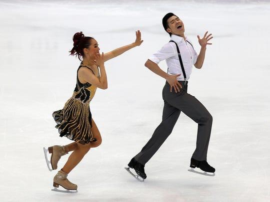 China's Zhang Yiyi and Wu Nan perform during the ice dancing short dance of the ISU Four Continents Figure Skating Championships in Taipei, Taiwan, Jan. 22, 2014.