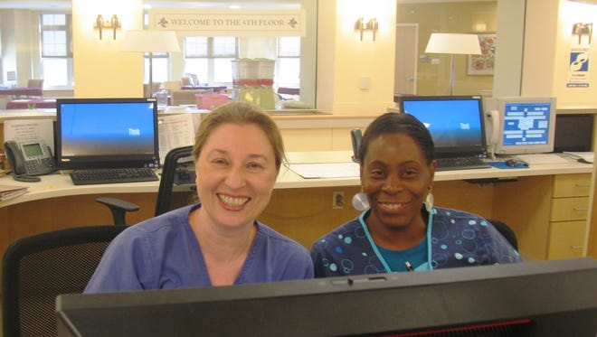 Staff at Roosevelt Care Center at Old Bridge at the nurses' station during a routine shift.