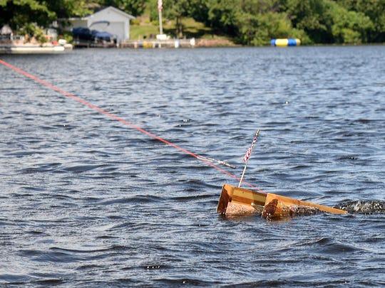 A strip-built trolling ski plies the waters of Lake Wissota near Chippewa Falls.