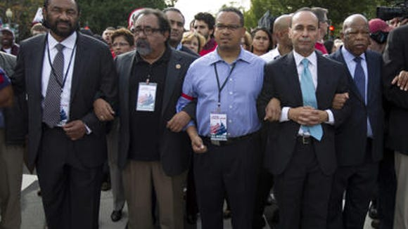 Democratic Reps. Raul Grijalva of Arizona, second from left, and Luis Gutierrez of Illinois, right, want President Barack Obama to go around House Republicans and implement immigration reform on his own.