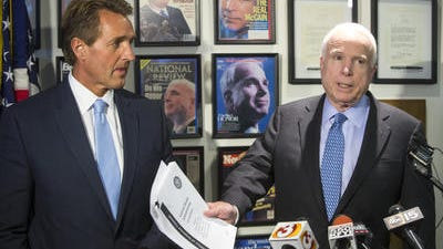 Arizona Republican Sens. Jeff Flake and John McCain, calling for VA Secretary Eric Shinseki to step down on May 28